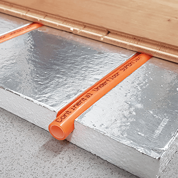pre-grooved insulation panels with a warm water underfloor heating pipe and engineered wood fitted over the top.